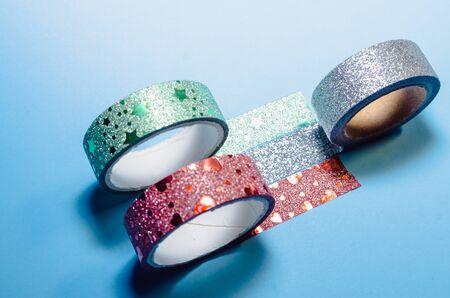 background of colorful washi tapes isolated on blue background