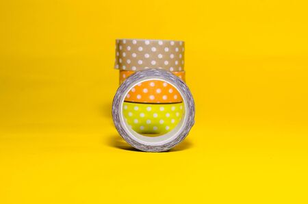 colorful washi tapes isolated on yellow background Imagens