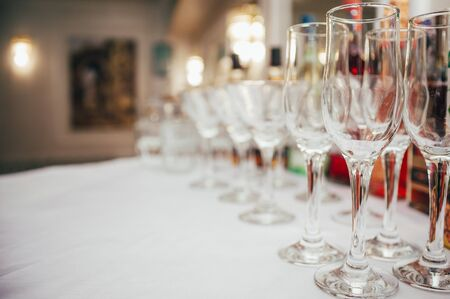 set of empty wineglasses in a line