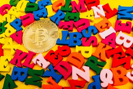 bitcoin on small colorful  wooden letters.  Crypto currency concept.