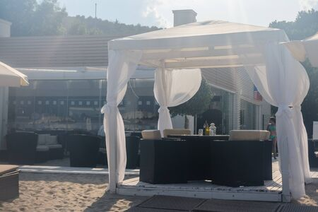 luxurious gazebo on the beach. White beach canopies. relaxation and tranquility design