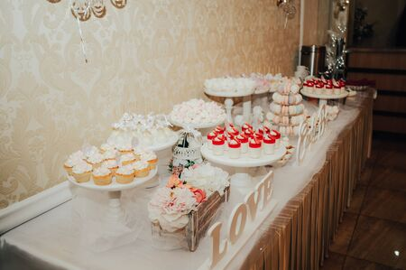 candy bar table with sweets and pop cakes on a holiday
