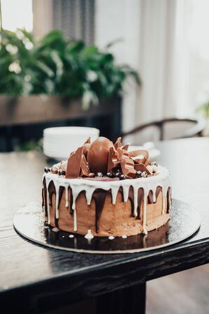 chocolate cake with chocolate bars on top