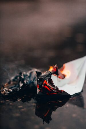 paper boat on fire. destroy your limits