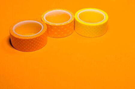 colorful washi tapes isolated on yellow background. Feminine stationery