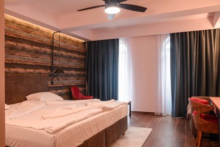 house bedroom interior design. bed with bedside table and lamp