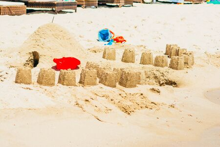 close up view of children playing with sand on the beach. making sand castles concept