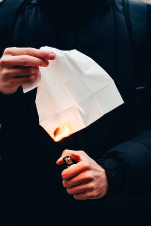 napkin on fire. start the fire concept