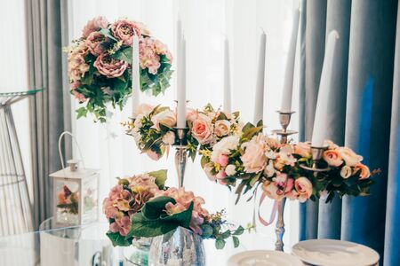 wedding decoration in restaurant . different candles and flowers