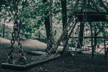 close up of abandoned playground during rain. gloomy place for children .