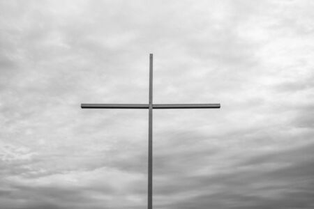 big cross with sea on the background. religion concept Stock Photo