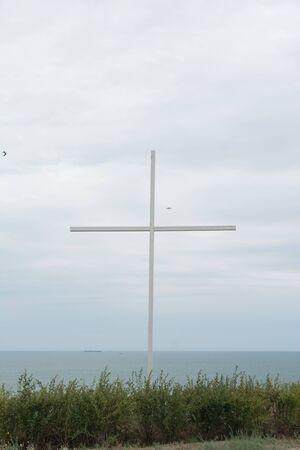 christian cross on a hill in an abandoned place with beautiful views and blue sky  . 스톡 콘텐츠