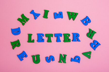 word LETTER made of wood letters.  multi colored letters around the word   .