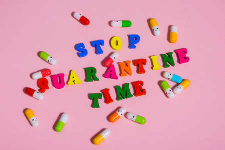 word STOP QUARANTINE TIME .   tablets around the word   .
