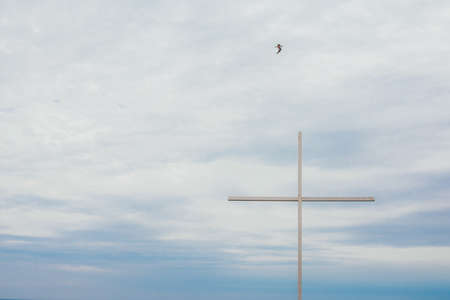 big cross with sea on the background. religion concept and selective focus .