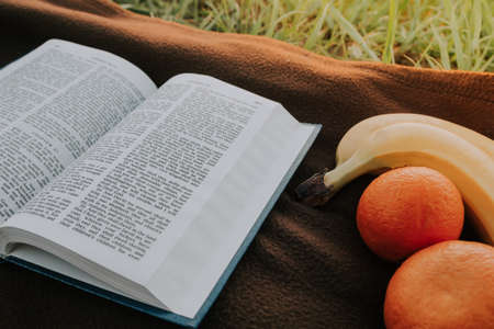 open bible  and fruits  . morning useful food . 스톡 콘텐츠