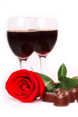 Two glasses of wine with rose and candy