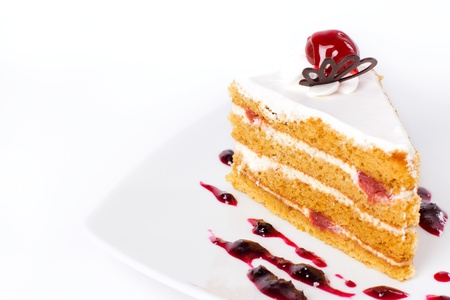 Single sweet cake on the white plate