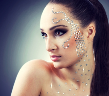 portait of beautiful girl with diamonds photo