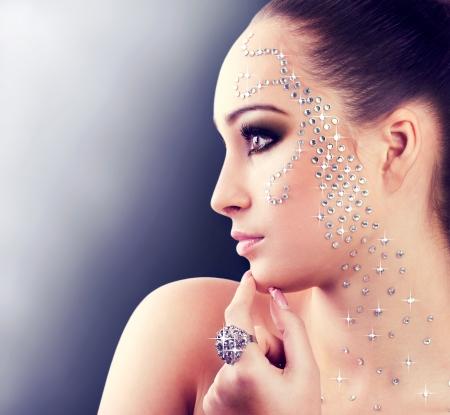 portait of beautiful girl with diamonds photo