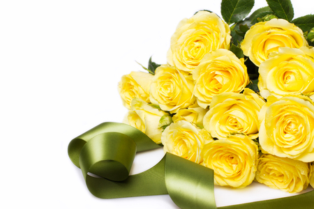 Beautiful bouquet of yellow roses with tape on white Reklamní fotografie