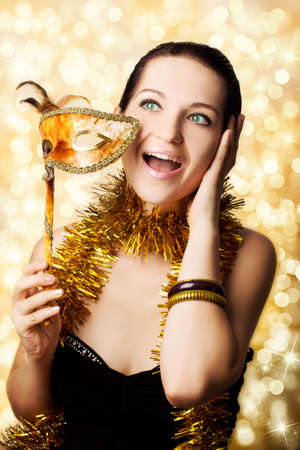 Beautiful surprised woman with carnival mask Stock fotó - 150640712