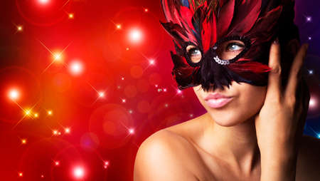 beautiful woman in carnival mask with copy-space
