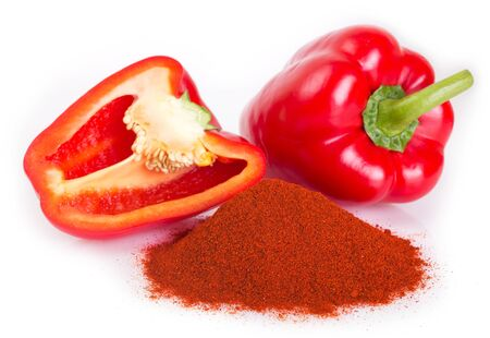 pile of ground paprika with pepper on white background