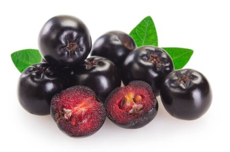 fresh chokeberry isolated on white background closeup