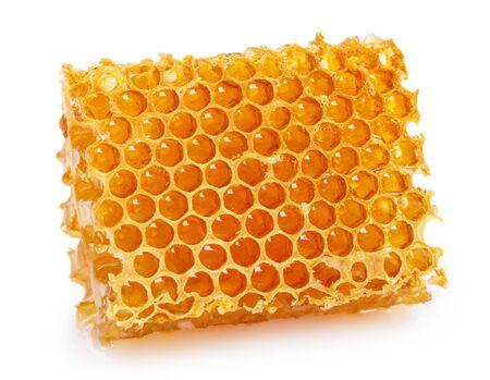 Wabe mit Honig isoliert auf weißem Hintergrund closeup