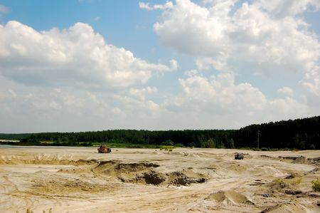 Open cast mine pit/ One truck,full, goes up and another,empty, goes down. Stock Photo - 1281933