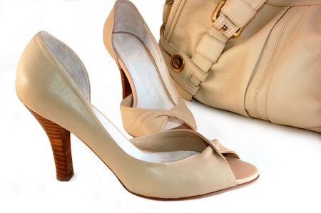 beige shoes and handbag isolated on white