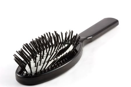 trashy: Black comb isolated on white