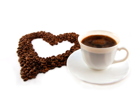cup of coffee with heart of coffee beans.  Stock Photo