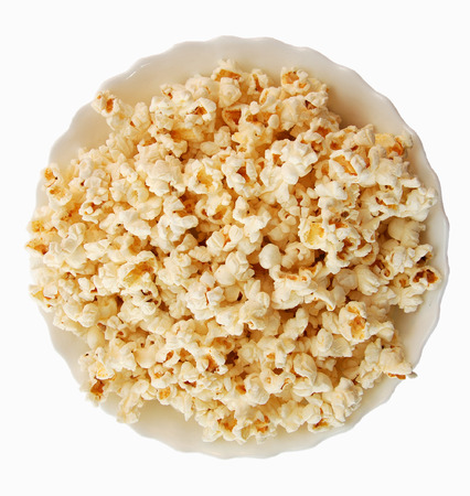 bowls of popcorn: popcorn and plate Stock Photo