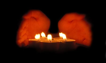 Hands cupped around a candle Stock Photo - 2334691