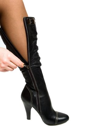 unzip: Woman leg in stocking isolated over white background   Stock Photo