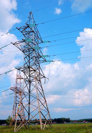 volts: Power lines and electric pylon agains a blue sky.