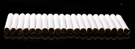 quiting smoking: white cigarettes on black background Stock Photo