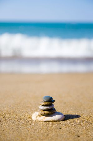 stones stacked up on beach