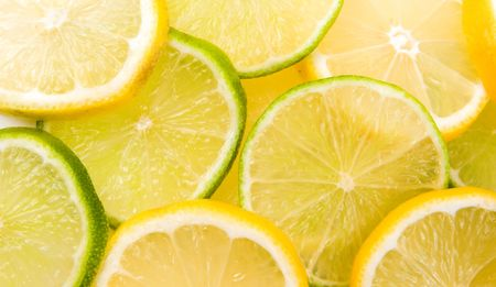 Lemon and lime slices abstract background Stock Photo