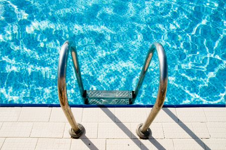 private public: Swimming pool steps   Stock Photo