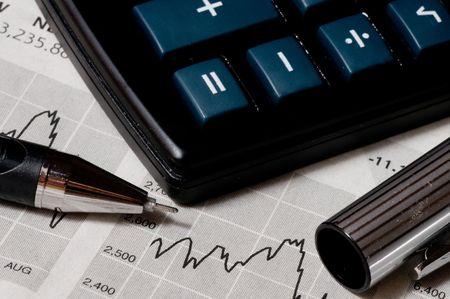 scrutiny: Business concept: the calculator, pen and diagram