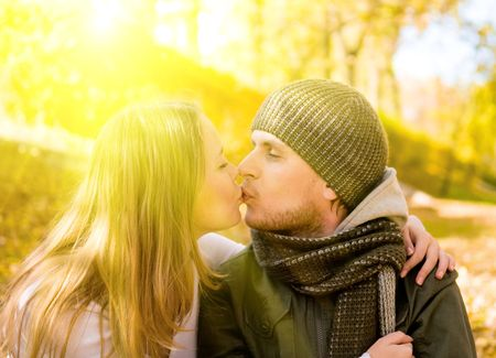 kissing couple in autumn park Stock Photo - 4743479