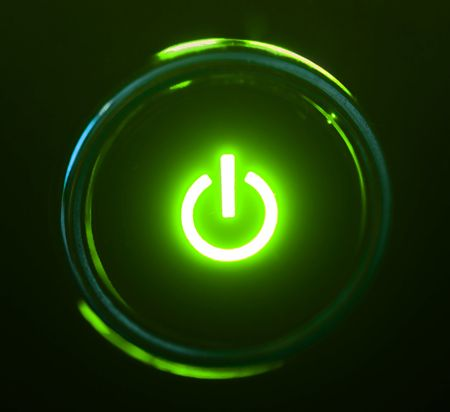 monitor power button closeup in darkness Stock Photo - 4743710