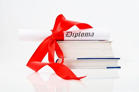 baccalaureate: Diploma with red ribbon and books on white background Stock Photo