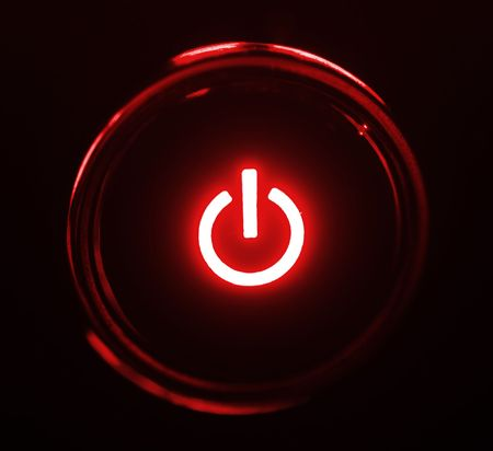 monitor power button closeup in darkness