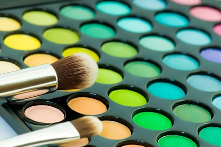 eyemakeup: multicolored eye shadows with cosmetics brush