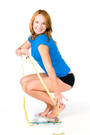 Happy woman on weight scale Stock Photo - 6876043