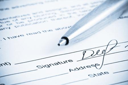 Signature. Close-up of a pen. Stock Photo